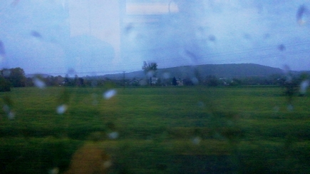 View onto rainy Krakow suburb from the train